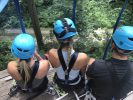 People in harness and helmets ready to go ziplining in the woods of Pennsylvania